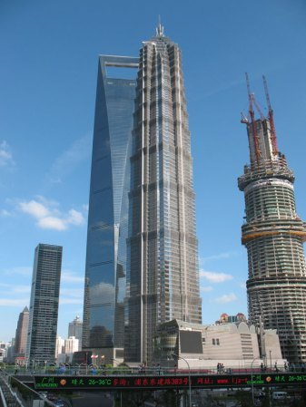 The 1,380 ft. Jin Mao Tower standing in front of the SWFC building. Next to it you can see construction on the Shanghai Tower. It will open in 2014 at a tall 2,073 ft.!!